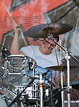 Walk the Moon drummer Sean Waugaman performs during the KROQ Weenie Roast y Fiesta Saturday in Irvine.