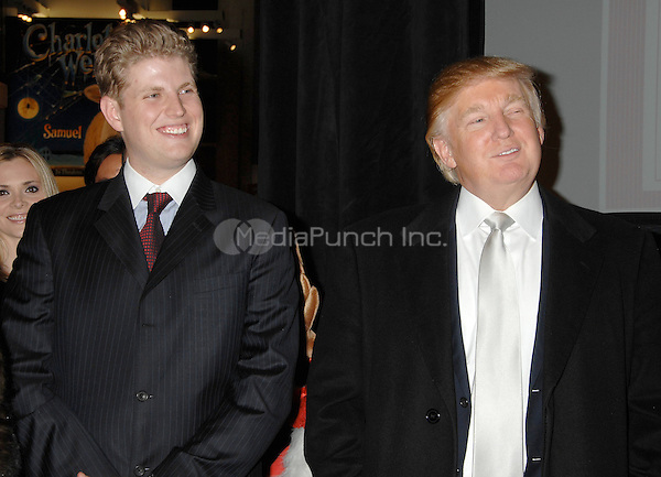 Eric Trump and Donald Trump attend the Trump Magazine and FAO Schwarz evening shopping fete to celebrate the birthdays of Vanessa and Donald Trump Jr. with a percentage of all proceeds from sales during the event to benefit Operation Smile, held in FAO Schwarz Fifth Avenue Store, Monday, December 11, 2006 in New York.<br />