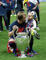 Calcio, finale di Champions League Juventus vs Barcellona all'Olympiastadion di Berlino, 6 giugno 2015.<br /> FC Barcelona's Ivan Rakitic shows the trophy to his daughter Althea at the end of the Champions League football final between Juventus Turin and FC Barcelona, at Berlin's Olympiastadion, 6 June 2015. Barcelona won 3-1.<br /> UPDATE IMAGES PRESS/Isabella Bonotto