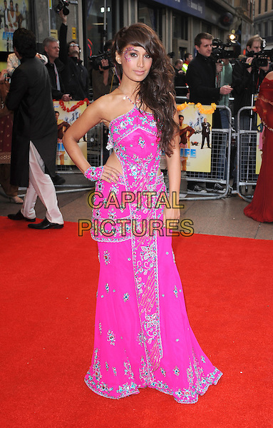 "PREEYA KALIDAS.The UK Premiere of ""It's A Wonderful Afterlife"", Odeon West End, London, England..12th April 2010.full length pink silver dress beads beaded embellished jewel encrusted hand on hip sari cut out sides .CAP/BEL.©Tom Belcher/Capital Pictures."