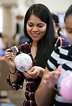 Janet Navarrete creates a paper mâché ornament during the La Posada Celebration at Western Nevada College, in Carson City, Nev., on Saturday, Dec. 15, 2018. <br /> Photo by Cathleen Allison/Nevada Momentum