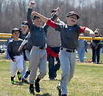 Some of the younger players run onto the field with an extra bit of enthusiasm after being introduced,   Saturday, April 21, 2018, during the opening day of Suffield little league. (Jim Michaud / Journal Inquirer)