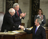 United States President George W. Bush shakes hands with US Vice President Dick Cheney after delivering his annual State of the Union Address to a Joint Session of the United Stats Congress in the Capitol in Washington, D.C. on January 31, 2006.  Speaker of the House Dennis Hastert (Republican of Illinois) applauds at center.<br /> Credit: Ron Sachs - CNP<br /> (RESTRICTION: NO New York or New Jersey Newspapers or newspapers within a 75 mile radius of New York City)