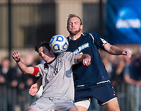 Steve Neumann (18) of Georgetown collides with Thomas Fiskerstrand (4) of San Diego during the game at North Kehoe Field in Washington, DC.  Georgetown defeated San Diego, 3-1.