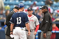 (L-R) Home plate umpire Justin Robinson Asheville Tourists manager Warren Schaeffer (13) Greenville Drive manager Darren Fenster (3) and first base umpire Chris Lloyd before a game between the Asheville Tourists and the Greenville Drive on April 16, 2015 in Asheville, North Carolina. The Tourists defeated the Drive 5-4. (Tony Farlow/Four Seam Images)