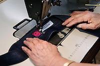 MAY 15, 2014 - KOJIMA, KURASHIKI, JAPAN: workers sew hand made ordered jeans at the Betty Smith's Sewing factory. (Photograph / Ko Sasaki)