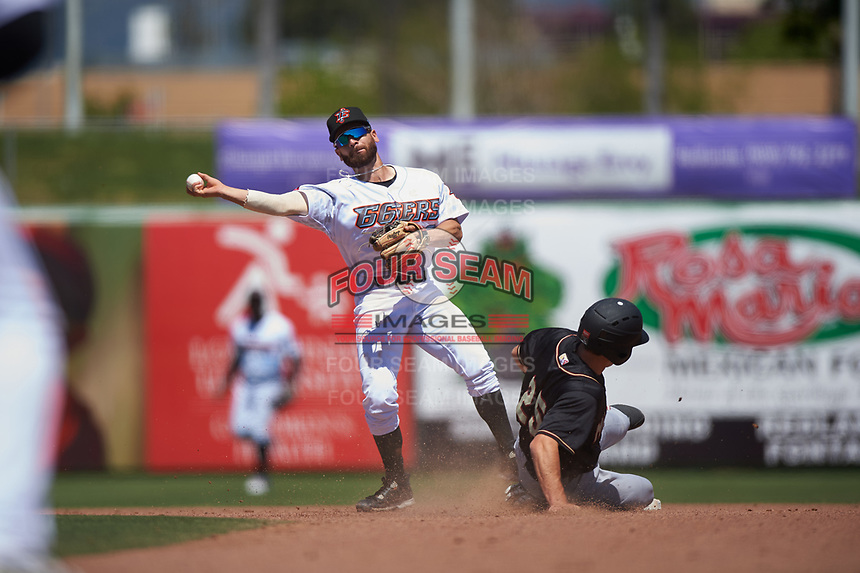 Inland Empire 66ers second baseman Alvaro Rubalcaba (12) throws to first base over Johnny Adams (25) during a California League game against the Modesto Nuts on April 10, 2019 at San Manuel Stadium in San Bernardino, California. Inland Empire defeated Modesto 5-4 in 13 innings. (Zachary Lucy/Four Seam Images)