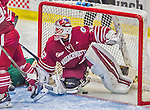 25 November 2014: University of Massachusetts Minutemen Goaltender Henry Dill, a Freshman from Columbus, Ohio, has the puck cross the goal line, but only after the whistle had sounded in the third period against the University of Vermont Catamounts at Gutterson Fieldhouse in Burlington, Vermont. The Cats defeated the Minutemen 3-1 to sweep the 2-game, home-and-away Hockey East Series. Mandatory Credit: Ed Wolfstein Photo *** RAW (NEF) Image File Available ***