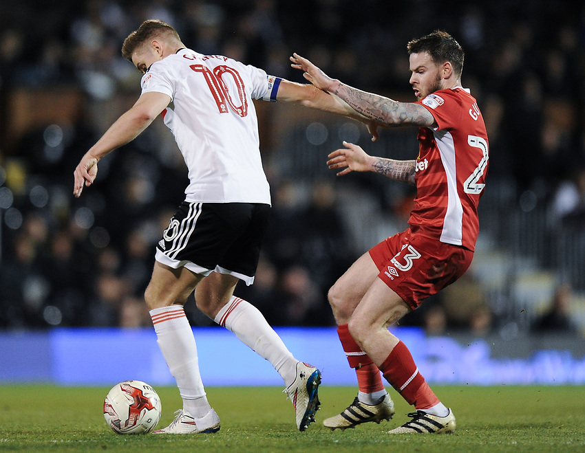 Blackburn Rovers' Danny Guthrie battles for possession with Fulham's Tom Cairney<br /> <br /> Photographer /Ashley WesternCameraSport<br /> <br /> The EFL Sky Bet Championship - Fulham v Blackburn Rovers - Tuesday 14th March 2017 - Craven Cottage - London<br /> <br /> World Copyright &copy; 2017 CameraSport. All rights reserved. 43 Linden Ave. Countesthorpe. Leicester. England. LE8 5PG - Tel: +44 (0) 116 277 4147 - admin@camerasport.com - www.camerasport.com