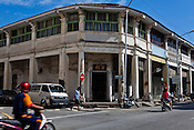 Motorists ride past heritage house in the UNESCO heritage town - Georgetown of Penang, Malaysia. Photo: Sanjit Das/Panos
