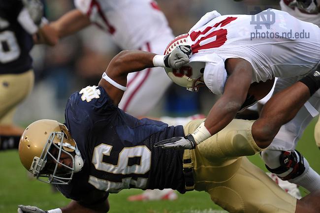 Linebacker Steve Filer (46) pulls down Stanford Cardinal kick returner Chris Owusu (81) on a kickoff in the second quarter...