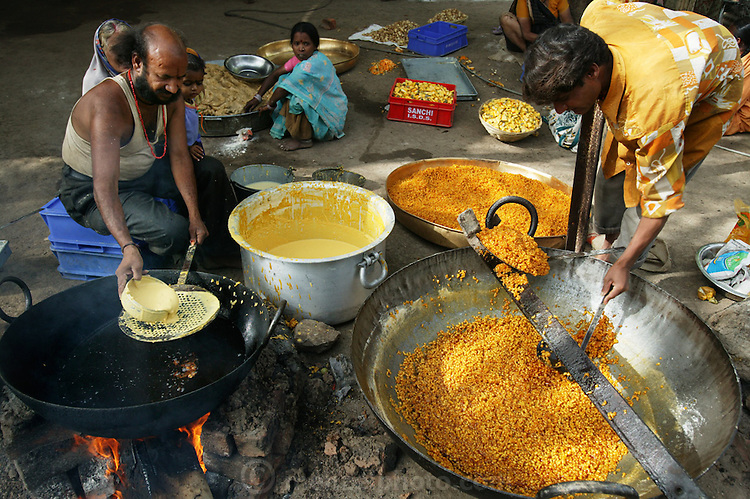 Preparing boondi in Ujjain, India, at one of the camps at the Kumbh Mela site. Every camp had its own large/small kitchen where food is prepared for people residing in that particular camp as well as outsiders who would walk in and out for lunch/dinner. Boondi can be a savory preparation or even sweet. (Supporting image from the project Hungry Planet: What the World Eats).