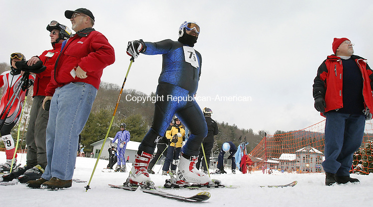 NEW HARTFORD, CT. 27 February 2007--022707SV12--Ed Bassett of Andover, Mass. watches skiers finish the Giant Slalom during the 14th annual winter games for seniors at Ski Sundown in New Hartford Tuesday.<br /> Steven Valenti Republican-American