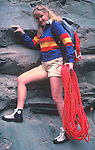 Woman with rock climbing equipment.