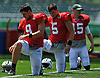 Bryce Petty #9, left, stretches with fellow quarterbacks Christian Hackenberg #5, center, and Josh McCown #15 before a day of New York Jets Training Camp at Atlantic Health Jets Training Center in Florham Park, NJ on Tuesday, Aug. 1, 2017.
