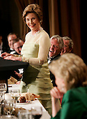 "First lady Laura Bush looks at Lynne Cheney as the audience and guests react in laughter at her comment about watching ""Desperate Housewives"" together after her husband goes to bed early during the annual White House Correspondents' Association dinner at the Washington Hilton in Washington, D.C., 30 April 2005.  The annual dinner began in 1914 as a bridge between the White House and its media corps and tonight feautured a mix of political insiders including Supreme Court Justices, Antonin Scalia and Stephen Breyer, and Hollywood elite such as Goldie Hawn and Richard Gere. <br /> Credit: Katie Falkenberg - Pool via CNP"