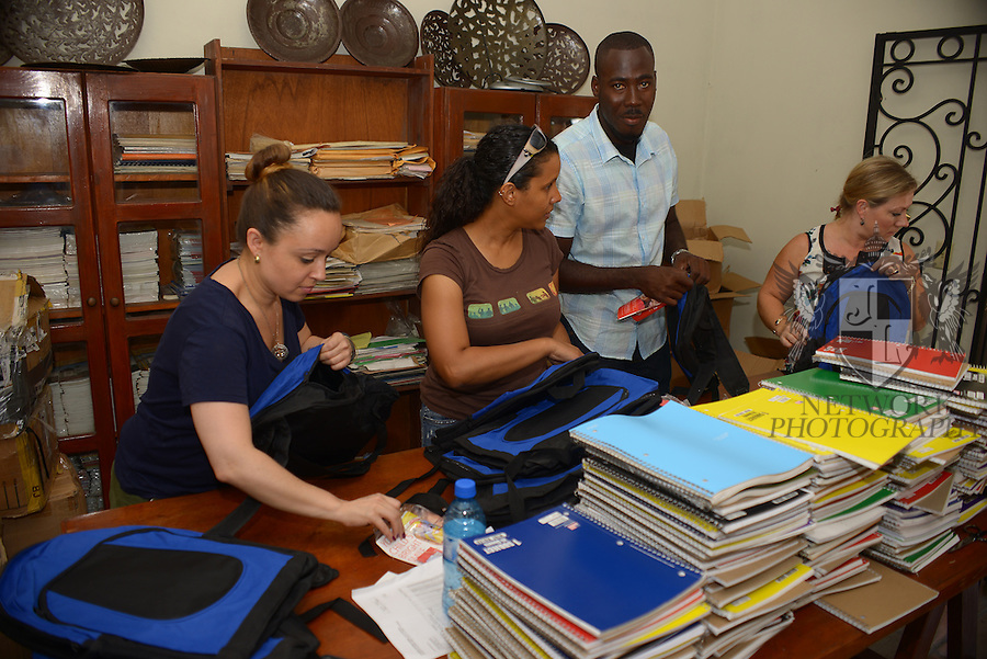 PORT-AU-PRINCE, HAITI - SEPTEMBER 24: Team Fleur De Vie preparing backpack for the 'Back to School Recreational Day' Make An Impact at Sun Auto Field in Tabarre, Port-Au-Prince Haiti on Friday September 24, 2014 in port-Au-Prince, Haiti (Photo by Johnny Louis/jlnphotography.com)