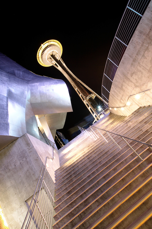Nighttime scene of stairs leading up past Experience Music Project to Seattle Space Needle, Seattle Center, Seattle, Washington, USA