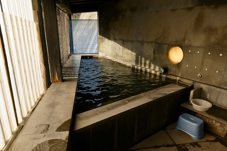 A small public hot spring designed by well known architect, Kengo Kuma. Ginzan Onsen, Yamagata Prefecture, Japan, April 13, 2016. Once a sliver-mining town, Ginzan Onsen in Yamagata Prefecture is now one of Japan's best-known and most picturesque hot spring resorts. Its Taisho-period architecture and retro atmosphere is said to have been an inspiration for Hayao Miyazaki's Oscar-winning animated film, Spirited Away.