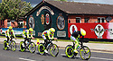 Team Neri Sottoli (ITA) cycle past pro-British Loyalist murals of east Belfast during practice session before the 2014 Giro d'Italia cycling race in Belfast, Northern Ireland, 09 May 2014. Belfast is hosting the Giro d'Italia Big Start (Grande Partenza) with three days of cycling action from 9 to 11 May 2014