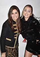 LOS ANGELES, CA - FEBRUARY 08: Emily Lazar (L) and Miley Cyrus attend MusiCares Person of the Year honoring Dolly Parton at Los Angeles Convention Center on February 8, 2019 in Los Angeles, California.<br /> CAP/ROT/TM<br /> &copy;TM/ROT/Capital Pictures