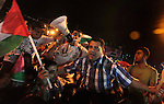 Palestinians celebrate in Gaza City on May 30, 2014, after Palestine qualified for their maiden Asian Cup appearance with a 1-0 win over injury-hit Philippines in the final of the AFC Challenge Cup in Maldives. Photo by Ashraf Amra