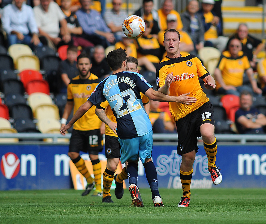 Newport County's Michael Flynn vies for possession with Wycombe Wanderers' Max Kretzschmar<br /> <br /> Photographer Kevin Barnes/CameraSport<br /> <br /> Football - The Football League Sky Bet League Two - Newport County AFC v Wycombe Wanderers - Saturday 9th August 2014 - Rodney Parade - Newport<br /> <br /> &copy; CameraSport - 43 Linden Ave. Countesthorpe. Leicester. England. LE8 5PG - Tel: +44 (0) 116 277 4147 - admin@camerasport.com - www.camerasport.com