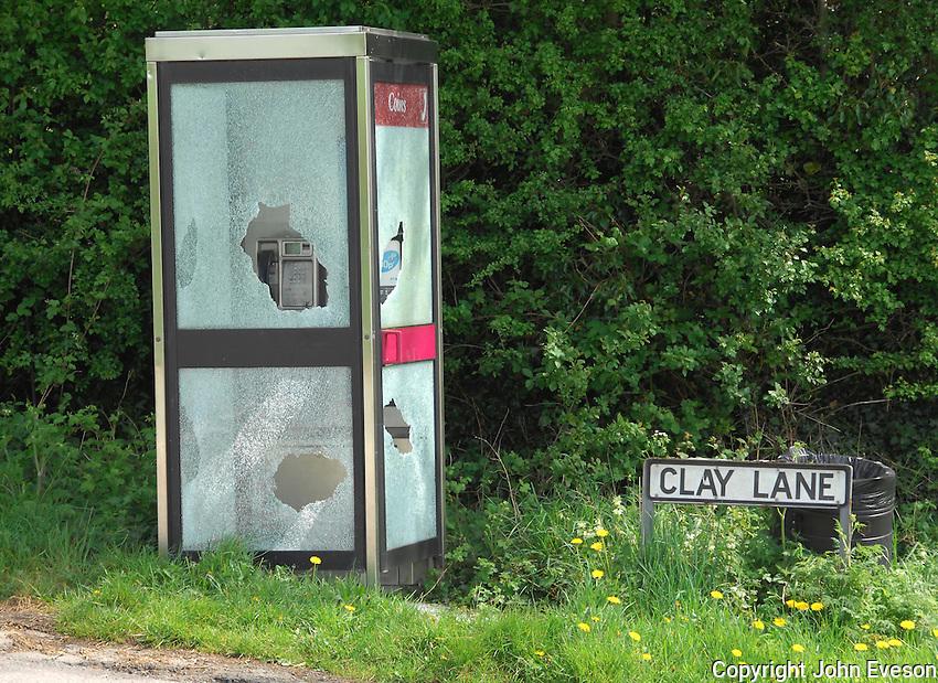 Vandalised telephone box, Cheshire.