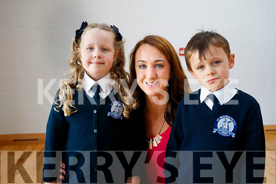 Twins Adam and Grace Roche with Denise Shanahan (SNA), pictured at the first day of school at Scoil Eoin, Balloonagh, Tralee, on Wednesday morning last.