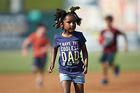 Young fans run the bases following the South Atlantic League game between the Greensboro Grasshoppers and the Piedmont Boll Weevils at Kannapolis Intimidators Stadium on June 16, 2019 in Kannapolis, North Carolina. The Grasshoppers defeated the Boll Weevils 5-2. (Brian Westerholt/Four Seam Images)