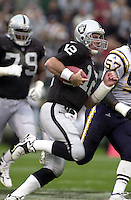 The Raider's Rich Gannon makes a run Sunday Nov. 14, 1999 at Network Associates Coliseum, Oakland, Calif.The Raiders beat San Diego 28-9.(Photo by Alan Greth)