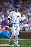Chicago Cubs pitcher Jon Lester (34) walks off the field during a game against the Milwaukee Brewers on August 13, 2015 at Wrigley Field in Chicago, Illinois.  Chicago defeated Milwaukee 9-2.  (Mike Janes/Four Seam Images)