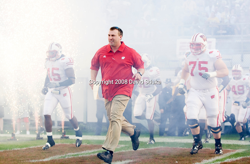 ORLANDO, FL - DECEMBER 27: Head coach Bret Bielema of the Wisconsin Badgers leads his team onto the field prior to the game against the Florida State Seminoles during the Champs Sports Bowl on December 27, 2008 at the Citrus Bowl in Orlando, Florida. Florido State beat Wisconsin 42-13. (Photo by David Stluka)