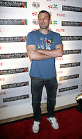 BEN AFFLECK.The Ante Up for Africa Celebrity Poker Tournament at the Rio Resort Hotel and Casino, Las Vegas, Nevada, USA..July 2nd, 2009.full length blue t-shirt arms crossed muscles jeans denim .CAP/ADM/MJT.© MJT/AdMedia/Capital Pictures