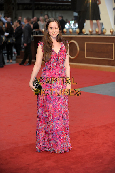 Anna Popplewell .The World Premiere of 'Anna Karenina', The Odeon Leicester Square, London, England..4th September 2012.full length pink blue print dress black clutch bag .CAP/PL.©Phil Loftus/Capital Pictures.