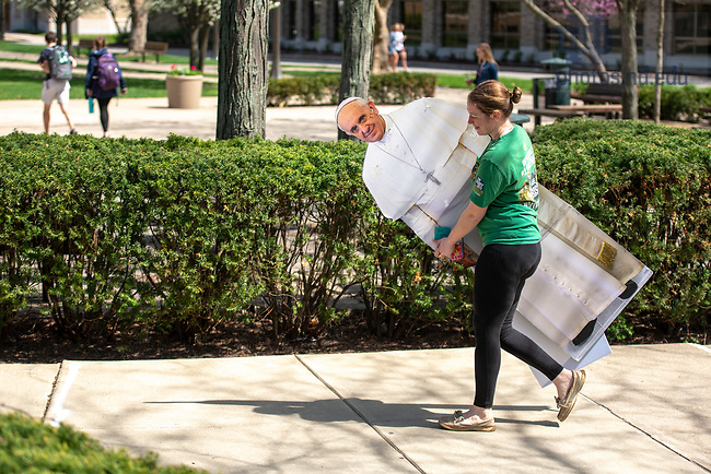 May 4, 2018; Student walks with a life size cutout of Pope Francis (Photo by Matt Cashore/University of Notre Dame)