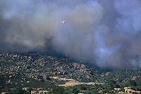 870000066 a fire fighting helicopter flies low over an uncontrolled 250,000 acre wildfire in the simi hills above chatsworth california