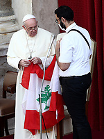 Pope Francis (L) speaks with Lebanese priest Georges Breidi, as they hold a Lebanese flag in remembrance of last month's explosion in Beirut, during the first limited public audience at the San Damaso courtyard in The Vatican on September 2, 2020 during the COVID-19 infection, caused by the novel coronavirus.<br /> UPDATE IMAGES PRESS/Isabella Bonotto<br /> <br /> STRICTLY ONLY FOR EDITORIAL USE