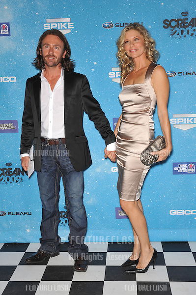 Kate Vernon & date at the 2009 Spike TV Scream Awards, at the Greek Theatre, Los Angeles..October 17, 2009  Los Angeles, CA.Picture: Paul Smith / Featureflash