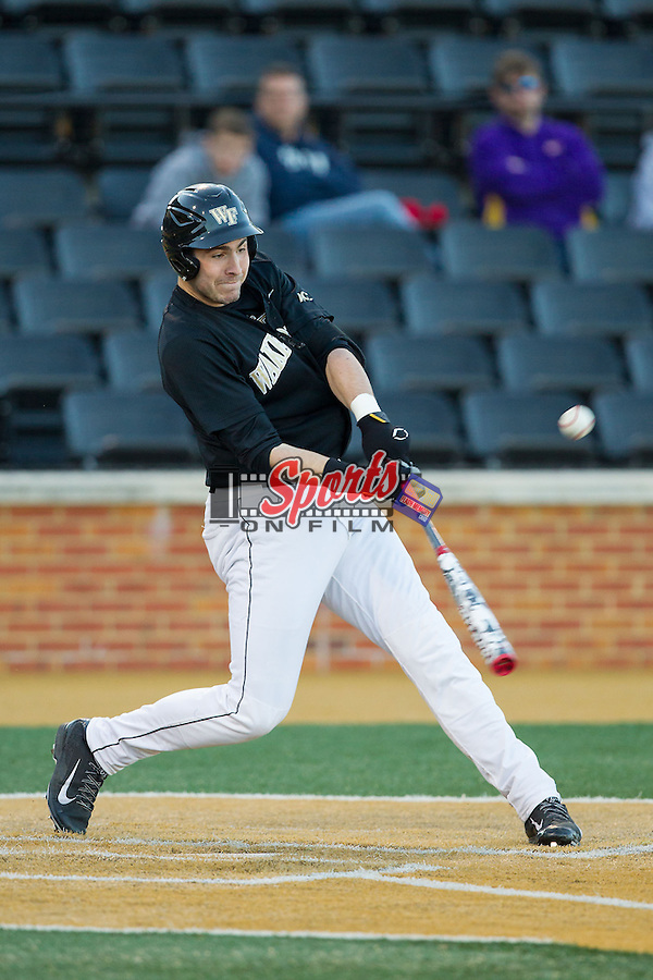 Matt Conway (25) of the Wake Forest Demon Deacons makes contact with the baseball against the Missouri Tigers at Wake Forest Baseball Park on February 22, 2014 in Winston-Salem, North Carolina.  The Demon Deacons defeated the Tigers 1-0.  (Brian Westerholt/Sports On Film)