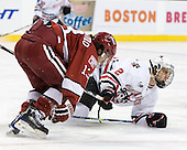 Michael Del Mauro (Harvard - 13), Drew Ellement (NU - 2) - The Northeastern University Huskies defeated the Harvard University Crimson 4-1 (EN) on Monday, February 8, 2010, at the TD Garden in Boston, Massachusetts, in the 2010 Beanpot consolation game.