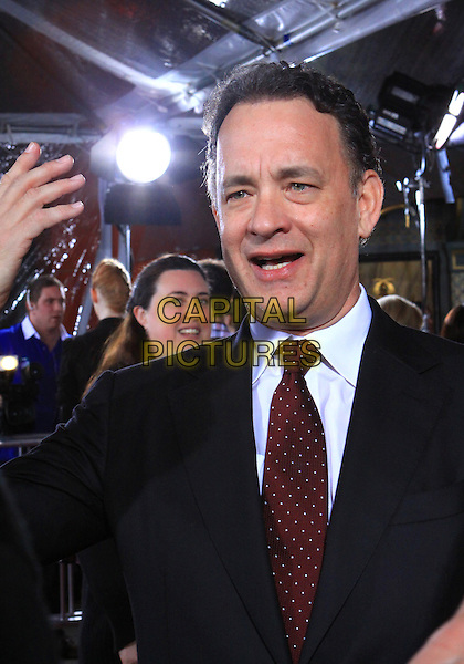 "TOM HANKS .Attending the Los Angeles Premiere of HBO's ""The Pacific"" held at Grauman's Chinese Theater, Hollywood, California, USA, 24th February 2010 .half length hand gesture funny mouth open tie red white shirt polka dot suit black .CAP/ADM/TC.©T. Conrad/AdMedia/Capital Pictures."