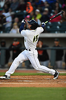 Left fielder Tim Tebow (15) of the Columbia Fireflies hits his first home run in a game against the Augusta GreenJackets on Opening Day, Thursday, April 6, 2017, at Spirit Communications Park in Columbia, South Carolina. Columbia won, 14-7. (Tom Priddy/Four Seam Images)