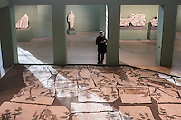 Sculptures and mosaic pavement in the boiler room. Centrale Montemartini. Rome, Italy. Mar. 07, 2015