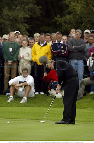 COLIN MONTGOMERIE (EUROPE)  attempts a putt on the 17th green, Foursomes Match, 34th Ryder Cup, The Belfry, Sutton Coldfield, 020928. Photo: Glyn Kirk/Action Plus....2002.golf golfer player.putts putting...... .....