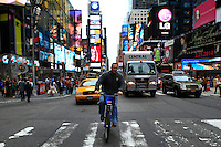 New York, USA. 28 May 2014. A man rides a citi bike along Times Square during the one year anniversary in New York. Photo by Eduardo Munoz Alvarez/VIEWpress