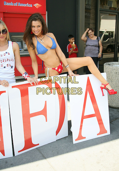 ALICIA ARDEN .Hollywood Actresses raise money for foreclosure victims at Bank of America, Hollywood, California, USA, .03 July 2008..half Full  length American flag patriotic bikini posing stars and stripes climbing leg over .CAP/ADM/MJ.©Michael Jade/Admedia/Capital Pictures