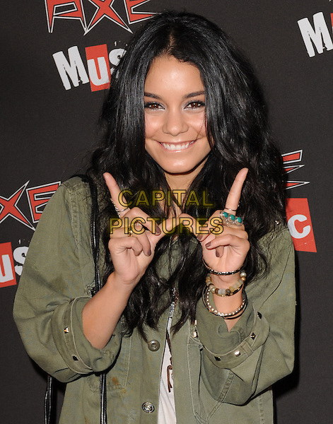 "VANESSA HUDGENS .The Axe Music ""One Night Only"" Concert series, Weezer headlines & takes over The Dunes Inn Motel in Hollywood, California, USA..September 21st, 2010 .half length green jacket white top necklaces bracelets w hands gesture smiling.CAP/RKE/DVS.©DVS/RockinExposures/Capital Pictures."