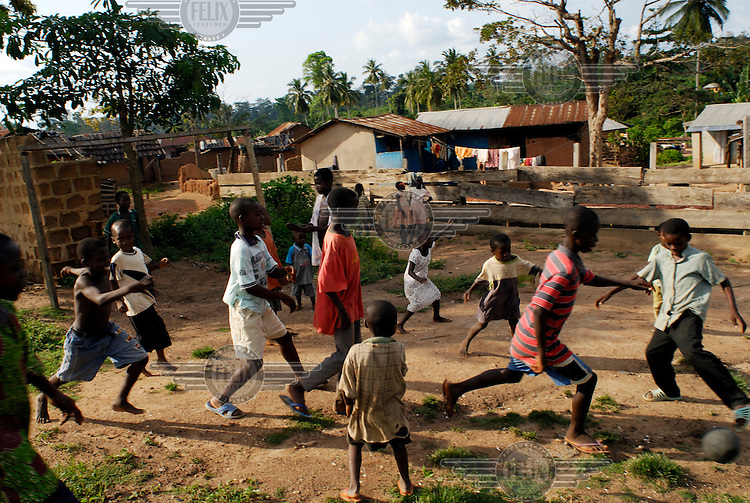 Children playing football in the village of Bayerobon 3, home to the Kuapa Kokoo cocoa co-operative. Kuapa Kokoo is a farmers' co-operative with 45,000 members spread across the forests of Kumasi. The farmers jointly own a 45 percent stake in the company, which is also a major stakeholder in the London-based fair trade company Divine Chocolate Ltd..