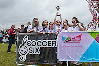 The Winning Girls team including Kerry Ingram (lifting cup) (Actress best known for Shireen Baratheon in the HBO series Game of Thrones) AJ AZARI (Aimee Jade) (left)(Creative Artist / Winner of STEPPING OUT UK) and partner of JLS Singer Oritse Williams, Kia Pegg (3rd Left) (Jody Jackson in TV Tracy Beaker returns), Chelcee Grimes (right) (Singer / Songwriter), Mia McKenna Bruce (2nd left) (Actress including Penny Branning in EastEnders),   during the SOCCER SIX Celebrity Football Event at the Queen Elizabeth Olympic Park, London, England on 26 March 2016. Photo by Andy Rowland.